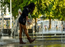 photo of a woman dancing at the Bill Naito Legacy Fountain in Portland Oregon