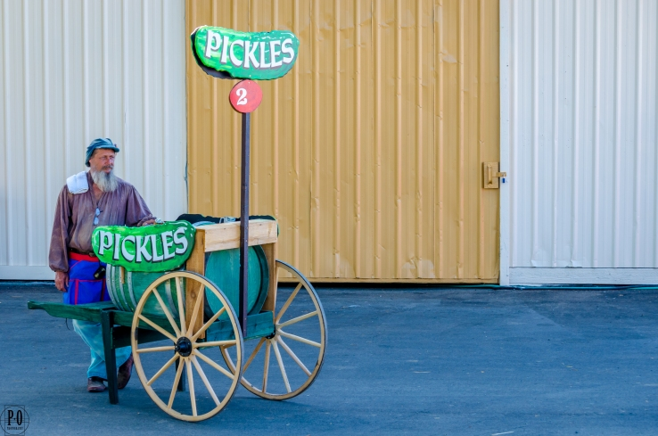 photo of pickle cart and merchant at the oregon renaissance festival