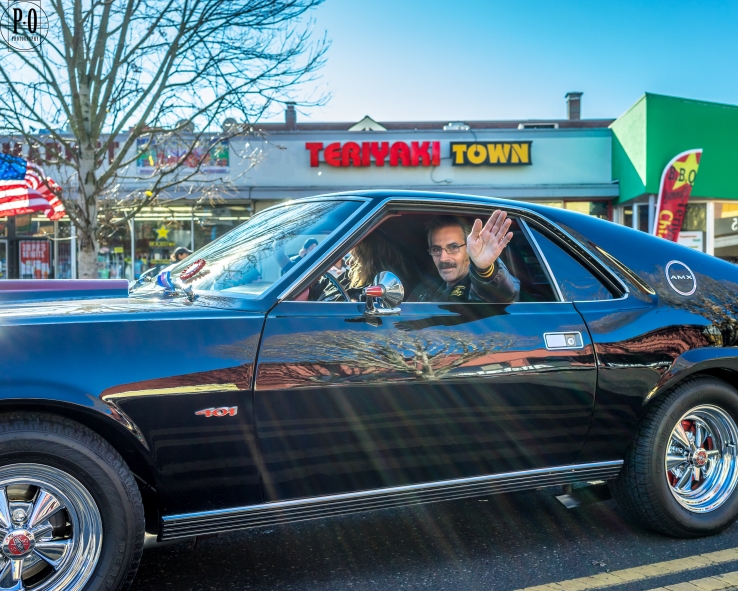 Photo of AMX 401 muscle car driver waving during the Veterans Day PDX parade by Paul Ottaviano