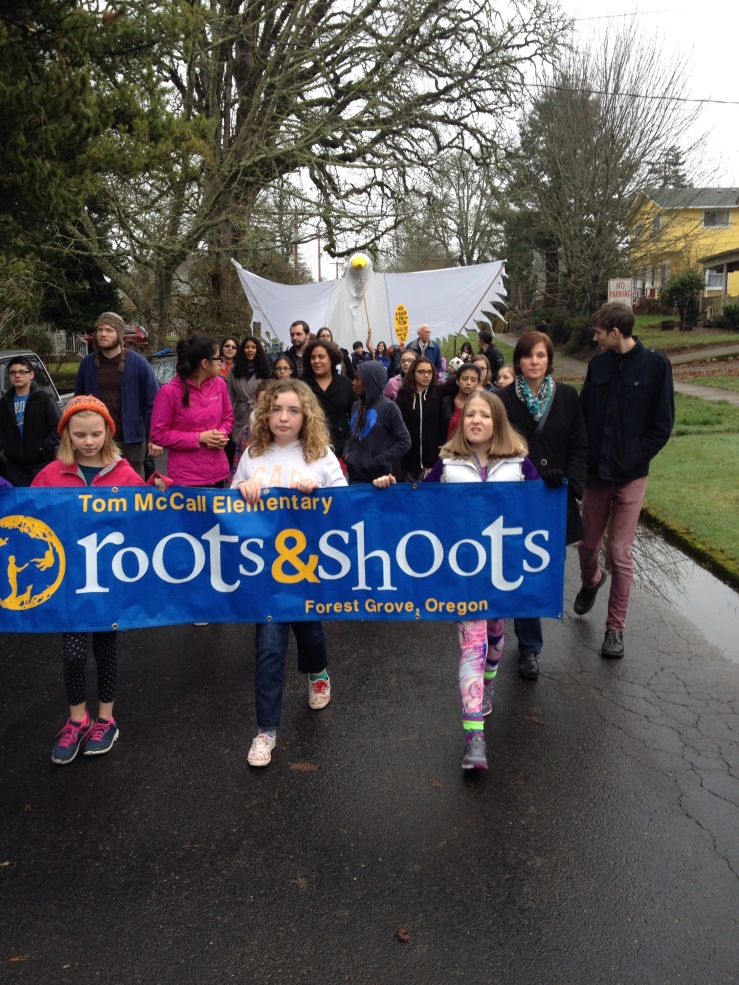 smart phone snap shot of Forest Grove MLK Day March in Forest Grove OR by Paul Ottaviano