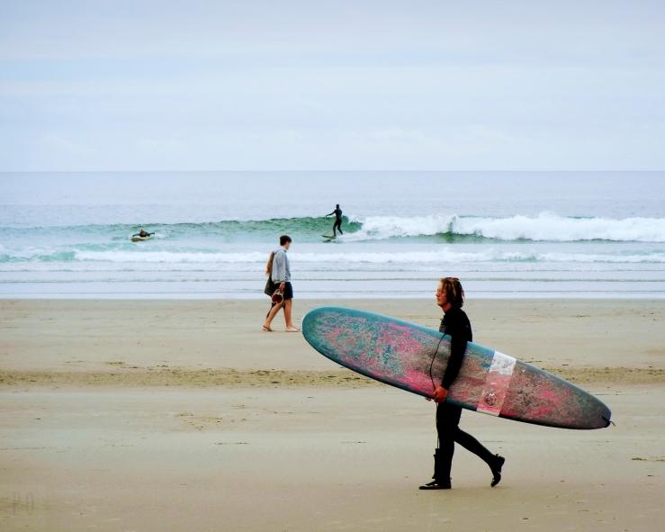 walking on the beach surfer couple short sands oregon