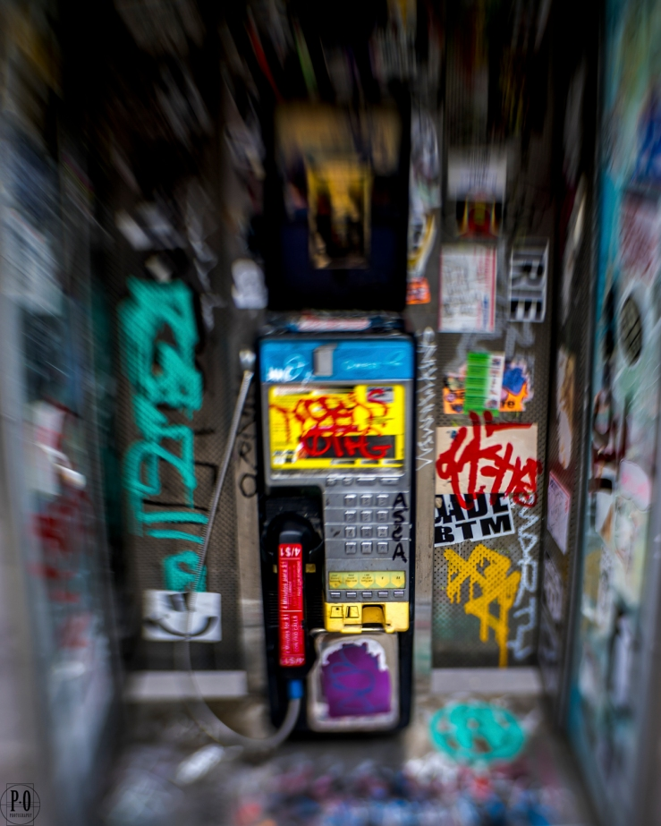 public pay phone covered with stickers portland oregon