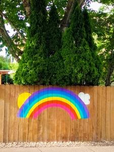 suburban street art rainbow fence covid-19