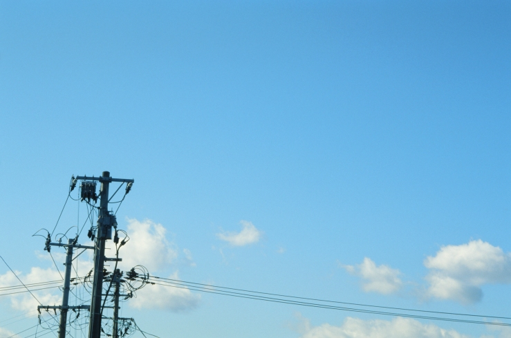 film photo of powerlines telephone lines and telephone poles